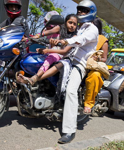 Indian family on motor bike on Mahatma Gandhi Road in Bangalore