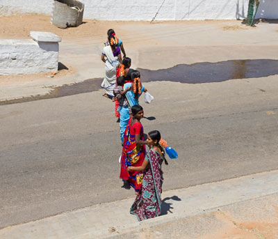Indian women crossing a road on Chamundi Hills outside Mysore, India