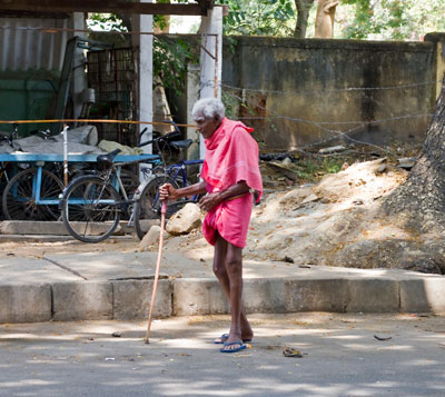 Older Indian man walking in Bangalore, India