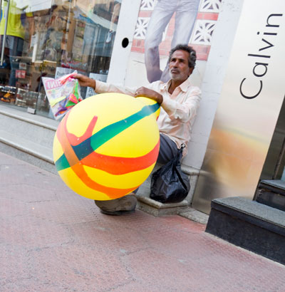 A street hawker selling large balloons in Bangalore, India