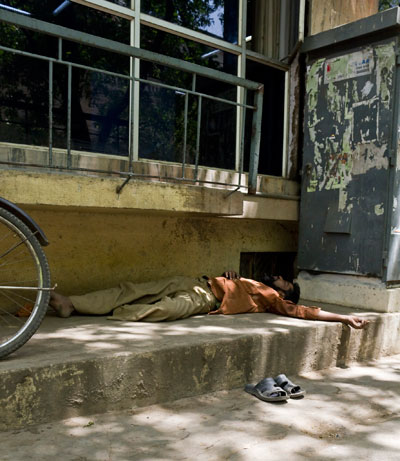 Indian man relaxing on the street in Bangalore, India